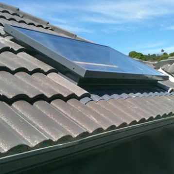 Glass Skylight including flashing for tile roof.